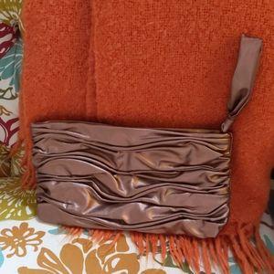 Shiny copper colored clutch